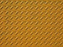 Yellow steel diamond plate background Stock Images