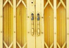 Yellow steel door Royalty Free Stock Image