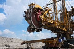 Yellow steel excavator in coal mine Royalty Free Stock Image