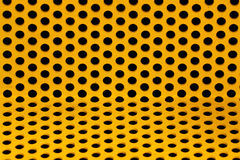 Yellow steel grid. A yellow steel grid thats bent towards the camera at the bottom royalty free stock photos