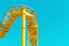 Yellow Steel Rollercoaster Rail Under Blue Sunny Sky during Daytime Stock Photography