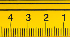Yellow steel ruler Royalty Free Stock Image