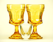 Yellow stemmed drinking glasse royalty free stock images