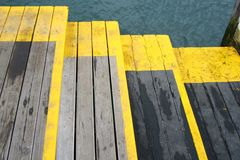 Yellow steps in dockyard Royalty Free Stock Images