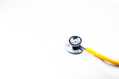 Yellow stethoscope. With white background stock images