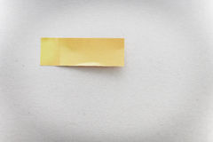 Yellow stick note on gray background Royalty Free Stock Photo