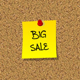 Yellow stick note paper with words BIG SALE pinned on cork board Royalty Free Stock Photography
