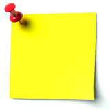 Yellow sticker. Attached drawing pin Royalty Free Stock Photos