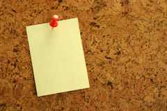 Yellow sticker. On cork board for announcements Royalty Free Stock Photos