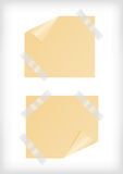Yellow stickers with curled corner and scotch tape Stock Images