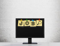 Yellow stickers are on the display with the word JOB as a symbol of the searching of the vacancies in the Internet. Stock Images