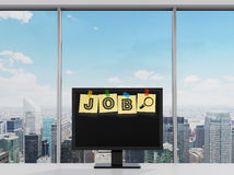 Yellow stickers are on the display with the word JOB as a symbol of the searching of the vacancies in the Internet. Stock Photo