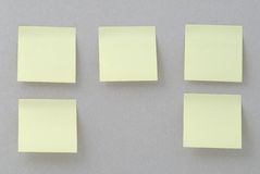 Yellow stickers on old paper background Stock Photos