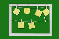 Yellow stickers for reminders. Blank yellow stickers on clothespins reminders Stock Image