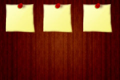 3 Yellow stickers on a wooden board background from notice, 3 red pin board Stock Photography
