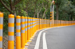 Yellow sticks on the road Stock Photos
