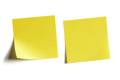 Yellow sticky note. Two yellow sticky note reminders on a white background stock image