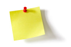 Yellow sticky note. Yellow post-it adhesive note with red push pin Stock Image