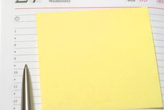 Yellow sticky note. And pensil on background Stock Photos