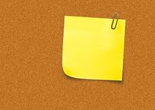 Yellow Sticky Note against a board. Digital composite of Yellow Sticky Note against a board Stock Photo