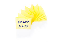 Yellow sticky note on block with message We Need Royalty Free Stock Photo