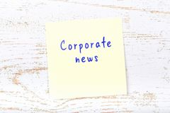 Yellow sticky note with handwritten text corporate news royalty free illustration