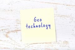 Yellow sticky note with handwritten text geo technology royalty free illustration