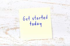 Yellow sticky note with handwritten text get started today vector illustration