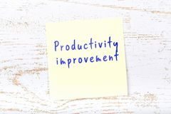 Yellow sticky note with handwritten text productivity improvement royalty free illustration