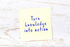 Yellow sticky note with handwritten text turn knowledge into action vector illustration