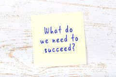 Yellow sticky note with handwritten text what do we need to succeed.  vector illustration