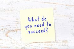 Yellow sticky note with handwritten text what do you need to succeed.  vector illustration