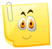 Yellow sticky note with happy face Royalty Free Stock Images
