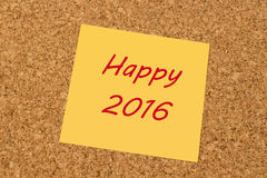 Yellow sticky note  - Happy New Year 2016. Yellow sticky note on an office cork board - Happy New Year 2016 Stock Photography
