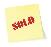 Yellow sticky note indicating item is sold. Isolated Royalty Free Stock Photo
