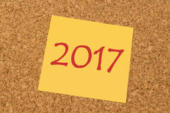 Yellow sticky note - New Year 2017 Stock Image