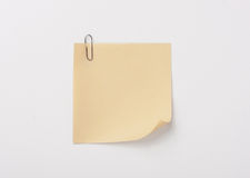 Yellow sticky note with paper clip with shade Stock Photos