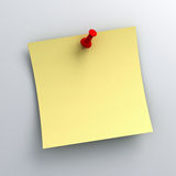 Yellow sticky note paper with red push pin on white background Stock Image