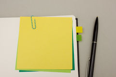 Yellow sticky note with pen Stock Image
