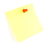 Yellow sticky note and push pin Royalty Free Stock Images