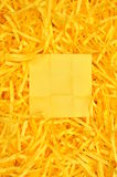 Yellow sticky note on shredded paper Stock Image
