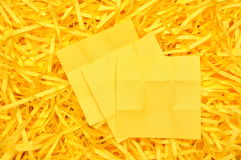 Yellow sticky note on shredded paper Royalty Free Stock Photo