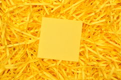 Yellow sticky note on shredded paper Stock Photos