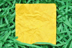 Yellow sticky note on shredded paper Stock Photo
