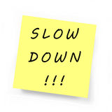 Yellow Sticky Note - SLOW DOWN. Yellow Sticky Note on white background Royalty Free Stock Images