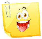 Yellow sticky note with smiling face Royalty Free Stock Photography