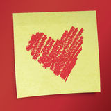 Yellow sticky note with Valentine`s heart. Stock Photography