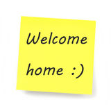 Yellow Sticky Note - Welcome home. Text Stock Photos
