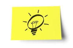Yellow sticky note on white background. Sticky note with drawing light bulb, isolated on white. clipping path included Stock Image