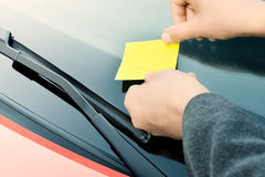 Yellow Sticky Note on a Windshield Royalty Free Stock Photography